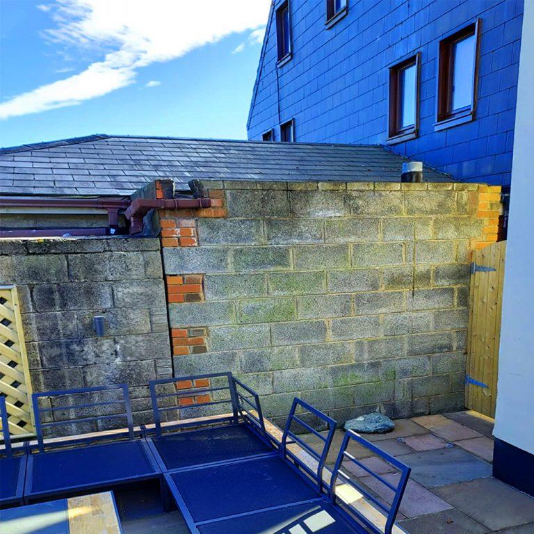 Unfinished back yard wall.